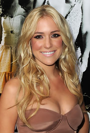 Kristin Cavallari stayed true to her blush tone dress and rocked nude lip gloss with a complementary bronzed glow.