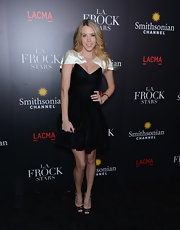 Kier Mellour rocked a funky black cocktail dress with white shoulder pieces while attending the 'LA Frock Stars' premiere.