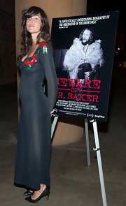 Paz de la Huerta attended the screening of 'Beware of Mr. Baker' wearing a dark green evening dress with an embellished neckline.