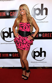Angel sported a playful printed peplum dress with an oversized belt and platform sandals.