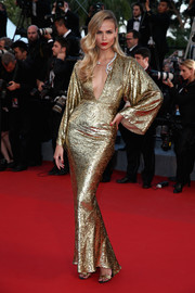Natasha Poly was a gilded beauty in a figure-hugging gold Michael Kors gown during the 'Sea of Trees' premiere in Cannes.