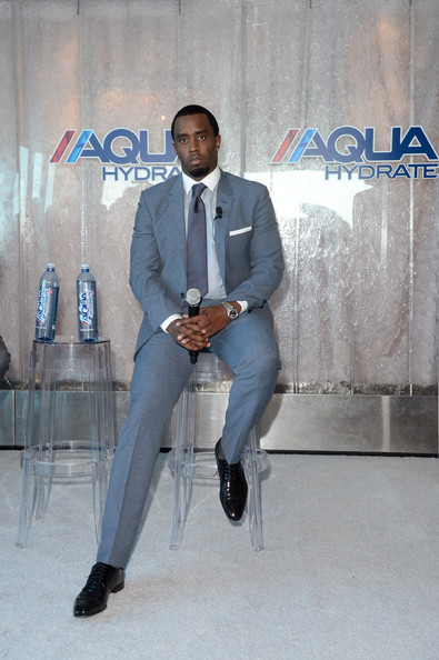 Sean Combs looked sharp at the Aquahydrate press conference in a gray suit.