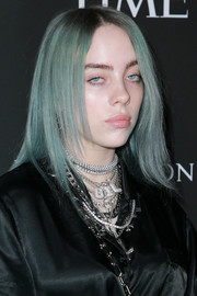 Billie Eilish accessorized with a ton of silver necklaces.