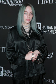 Billie Eilish went for edgy styling with a studded black shoulder bag at the Sean Penn J/P HRO Gala.