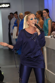 Lafee performed at Mercedes-Benz Fashion Week in Berlin wearing a ruched midnight blue boatneck sweater embellished with beads.