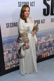 Leah Remini accessorized with a fur scarf for added glamour.