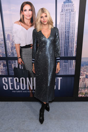 Devon Windsor was all ashimmer in a slate-blue sequined dress at the world premiere of 'Second Act.'