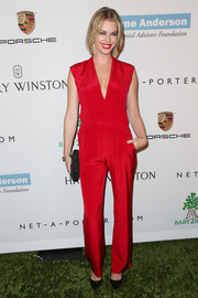 Rebecca Romijn attended the Baby2Baby Gala looking ravishing in a sleeveless red jumpsuit.