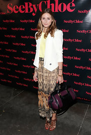 Olivia Palermo sported a classic blazer over her pale yellow top and tribal-print skirt.
