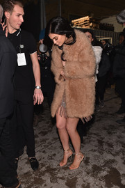 Kylie Jenner was spotted out during New York Fashion Week looking posh in a tan fur coat.