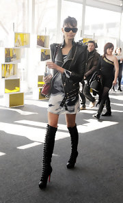 Chanel Iman strutted through Lincoln Center in black leather military-inspired over-the-knee boots.
