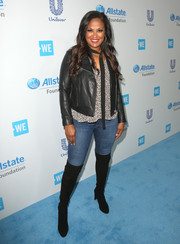 Laila Ali teamed a black leather jacket with a print blouse and skinny jeans for her WE Day California look.
