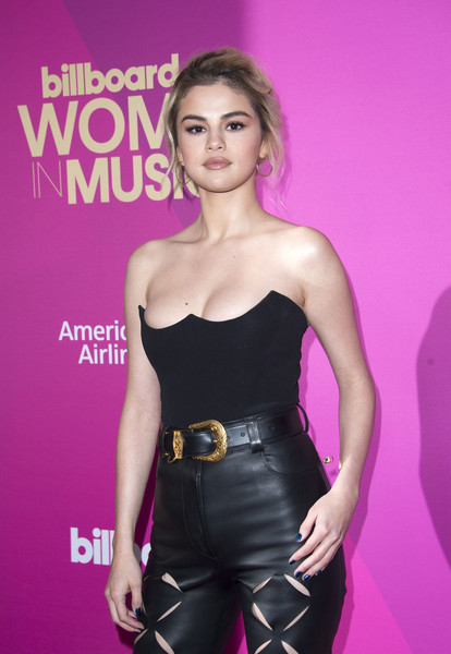 Selena Gomez Leather Belt [photo,clothing,hairstyle,beauty,dress,premiere,fashion,purple,lip,model,fashion model,selena gomez,valerie macon,billboard women in music 2017,arrivals,ray dolby ballroom,california,hollywood,afp]