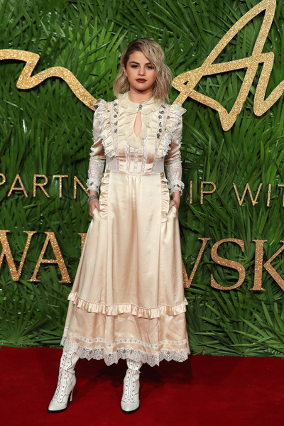 Selena Gomez Lace Up Boots [photo,clothing,dress,carpet,formal wear,red carpet,fashion,premiere,flooring,fashion design,gown,red carpet arrivals,selena gomez,the fashion awards 2017,partnership with swarovski,red carpet,american,afp,british fashion awards,arrival]