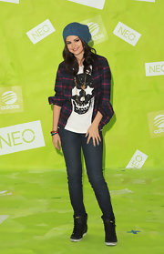 Selena gave off a grungy '90s vibe in a plaid button-down with disheveled sleeves.