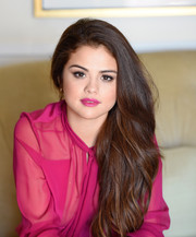 Selena Gomez sported fuchsia lipstick, which perfectly matched her outfit!