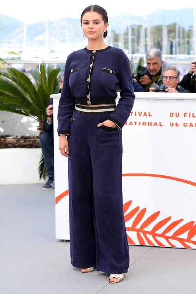Selena Gomez Cardigan [the dead dont die,clothing,fashion,street fashion,suit,pantsuit,waist,uniform,trousers,white-collar worker,style,selena gomez,photocall,photocall,cannes,france,the 72nd annual cannes film festival]