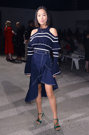 Aimee Song showed off her trendy fall style with this striped navy cold-shoulder sweater by Self-Portrait during the brand's fashion show.
