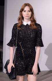Karen Gillan paired a quilted leather bag by Chanel with a sequined mini dress for the Self-Portrait fashion show.