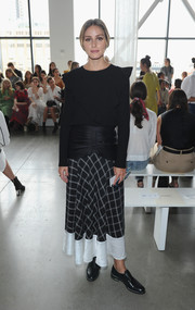 For her footwear, Olivia Palermo went menswear-chic with a pair of black leather slip-ons.