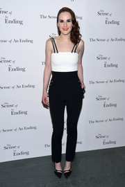 Michelle Dockery went for relaxed elegance in a black-and-white David Koma jumpsuit with multiple spaghetti straps at the screening of 'The Sense of an Ending.'