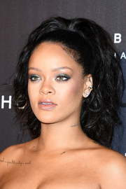 Rihanna made her eyes pop with a swipe of green eyeshadow.
