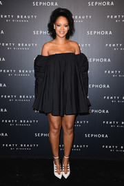 Rihanna chose a loose off-the-shoulder LBD by Calvin Klein for the Fenty Beauty launch in Paris.