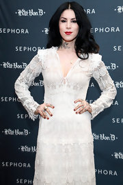 Kat Von D matched her lips and fingertips by sweeping on a rich red lipstick and lacquer.