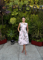 Miranda Kerr paired her sweet dress with elegant silver sandals.