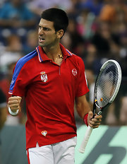 Novak Djokovic couldn't be stopped at the Davis Cup - here wearing a bright red top and gold cross.