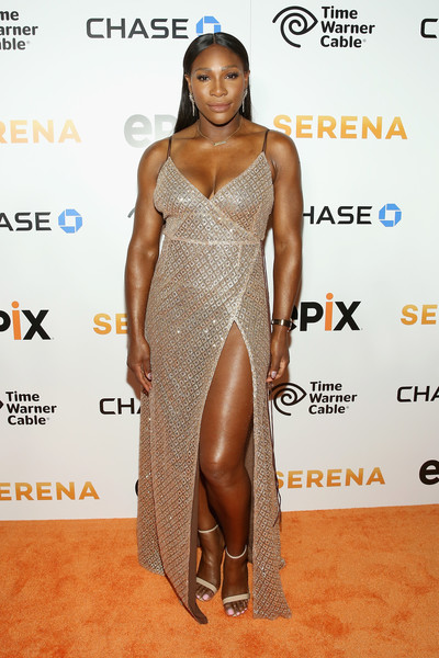 Serena Williams let her dress do the talking by pairing it with basic nude ankle-strap heels.