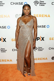 Serena Williams burned up the orange carpet in this mega-sultry metallic wrap gown by LaQuan Smith, boasting a low neckline and a dangerously high slit, during the premiere of 'Serena.'