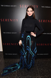 Anne Hathaway bundled up in a black turtleneck bodysuit by Wolford for the New York screening of 'Serenity.'