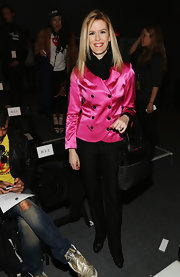 Because she wore a pink blazer, Alex McCord chose to keep her bottoms simple with black slacks.