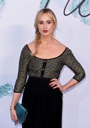 Elisabeth von Thurn und Taxis paired a teal velvet bag with a two-tone frock for the Serpentine Gallery Summer Party.