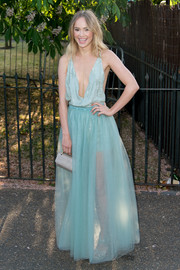 Suki Waterhouse polished off her ensemble with a gray croc-embossed purse by M2Malletier.