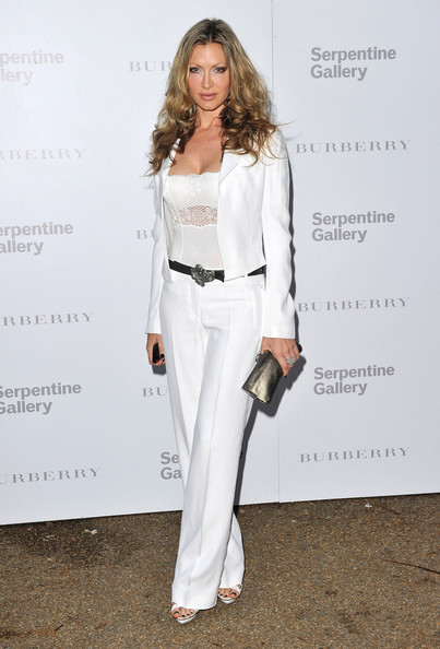 For the Serpentine Gallery Summer Party in London Caprice paired her white pantsuit with a sheer lacy camisole for a sexy finish.