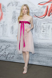 Ellie Bamber finished off her look with silver ankle-strap heels by Jimmy Choo.