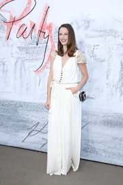 Kaya Scodelario donned a white Chanel jumpsuit with metallic cap sleeves for the Serpentine Summer Party 2018.