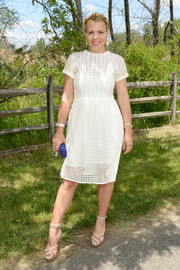 Busy Philipps completed her charming ensemble with nude cross-strap wedges by Lanvin.