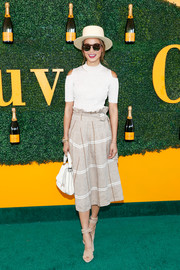 Jamie Chung teamed her top with a beige grid-print skirt.