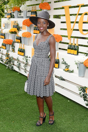 Lupita Nyong'o added a touch of edge to her look with studded black wedges by Christian Louboutin.