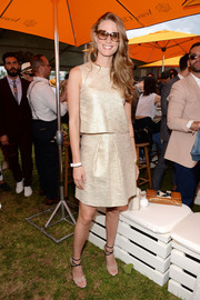 Julie Henderson shone in a sleeveless gold blouse by Rebecca Vallance during the Veuve Clicquot Polo Classic.
