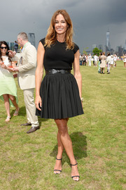 Kelly Bensimon teamed her top with a flared black mini skirt for a girly finish.