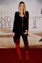 Jennifer added major color to her look with satin over the knee boots.