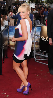Emma looked amazing in a printed mini dress with stunning purple and black suede pumps.
