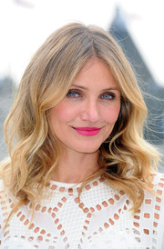 Cameron Diaz went for a boho vibe with this center-parted wavy 'do at the 'Sex Tape' photocall in London.