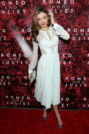 Miranda Kerr went for a modern vibe in a sheer-panel white dress with a geometric-patterned bodice during the Broadway opening of 'Shakespeare's Romeo and Juliet.'
