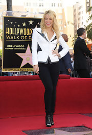 Shakira received her star on the Hollywood Walk of Fame rocking a white blazer with black leather trim.