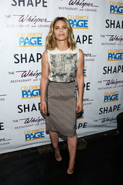 Jillian Michaels chose a stylish striped pencil skirt to team with her top.